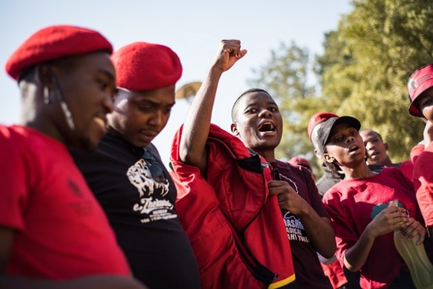 Bonginkosi Khanyile, with raised fist, on the lawns of the Union Buildings, in the hopes of speaking to President Cyril Ramaphosa to ask for a presidential pardon regarding the public violence charges against him. Khanyile is being accompanied by fellow EFF Student Command members and his mother, Phumzile Khatini, who travelled from KwaZulu-Natal to join her son, 21 August 2018, Pretoria. Picture: Jacques Nelles