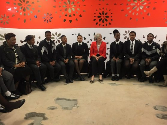 Theresa May with pupils in Gugulethu. Picture: Dirco/@NelsonKgwete