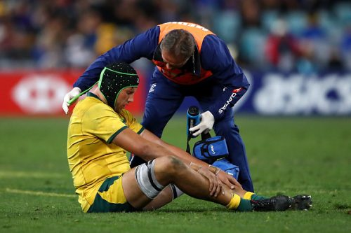 Adam Coleman of the Wallabies receives attention during The Rugby Championship Bledisloe Cup match between the Australian Wallabies and the New Zealand All Blacks at ANZ Stadium on August 18, 2018 in Sydney, Australia.  (Photo by Cameron Spencer/Getty Images)