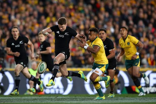 Beauden Barrett of the All Blacks kicks ahead during The Rugby Championship Bledisloe Cup match between the Australian Wallabies and the New Zealand All Blacks at ANZ Stadium on August 18, 2018 in Sydney, Australia.  (Photo by Cameron Spencer/Getty Images)