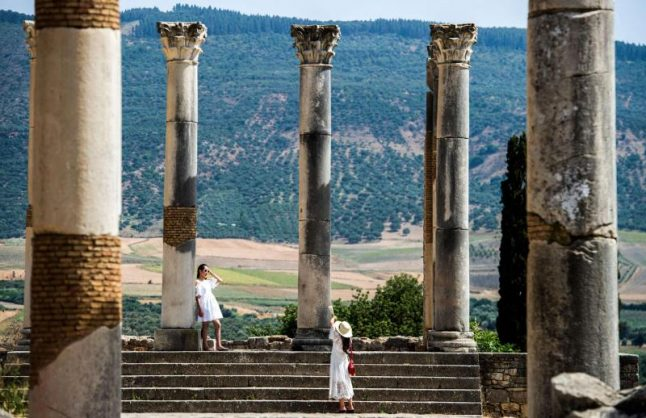 Tourists walk through the ruins of the ancient Roman site of Volubilis, near the town of Moulay Idriss Zerhounon in Morocco's north central Meknes region. Picture: AFP