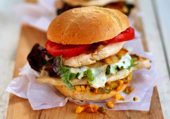 Chicken burger with atchar and mint raita. Picture: Supplied