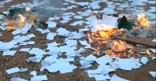 Ballot papers burning. Picture: Daso