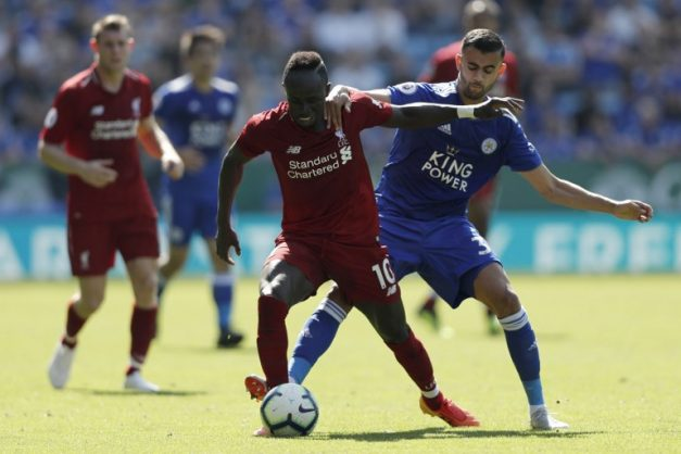 Liverpool's Senegalese striker Sadio Mane (L) vies with Leicester City's Algerian midfielder Rachid Ghezzal during the English Premier League football match between Leicester City and Liverpool at King Power Stadium in Leicester, central England on September 1, 2018. / AFP PHOTO / Adrian DENNIS / RESTRICTED TO EDITORIAL USE. No use with unauthorized audio, video, data, fixture lists, club/league logos or 'live' services. Online in-match use limited to 120 images. An additional 40 images may be used in extra time. No video emulation. Social media in-match use limited to 120 images. An additional 40 images may be used in extra time. No use in betting publications, games or single club/league/player publications. /