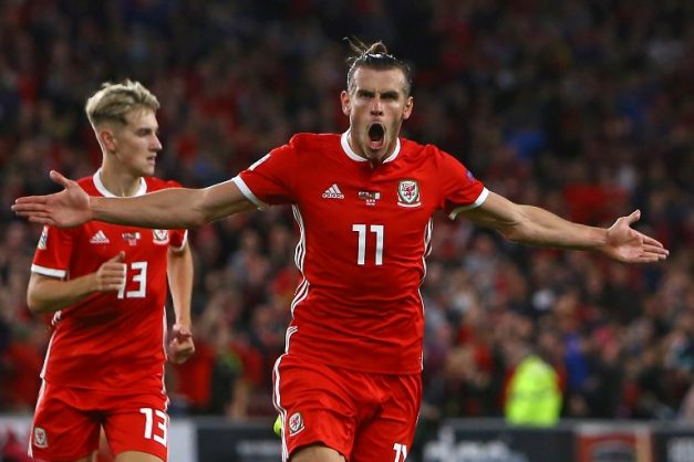 Wales' striker Gareth Bale celebrates after scoring their second goal during the UEFA Nations League football match between Wales and Republic of Ireland at Cardiff City Stadium in Cardiff on September 6, 2018. / AFP PHOTO / Geoff CADDICK