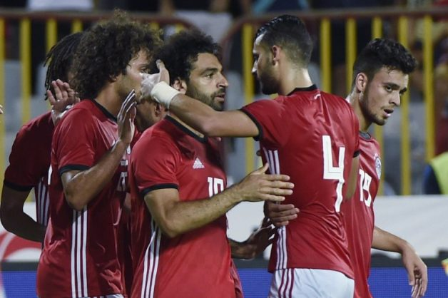 Egypt's Mohamed Salah (C) celebrates his goal with teammates during the Africa Cup of Nations qualifier match between Egypt and Niger on September 8, 2018 in Borg el-Arab stadium near the Mediterranean city of Alexandria.  / AFP PHOTO / Khaled DESOUKI