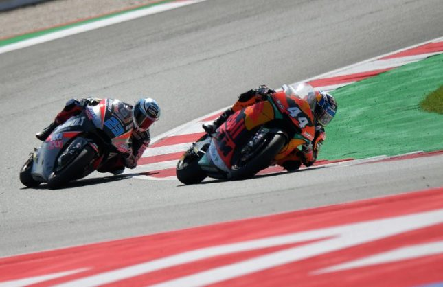 Red Bull KTM Ajo's rider Portuguese Miguel Oliveira competes followed by Dynavolt Intact GP's rider German Marcel Schrotter during the Moto2 race of the San Marino Grand Prix at the Marco Simoncelli Circuit in Misano on September 9, 2018. / AFP PHOTO / Tiziana FABI