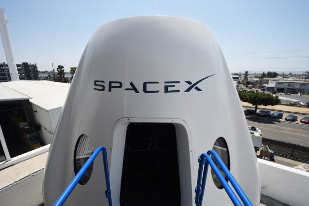 (FILES) In this file photo taken on August 13, 2018 a mock up of the Crew Dragon spacecraft is displayed during a media tour of SpaceX headquarters and rocket factory in Hawthorne, California.  SpaceX on Thursday, September 13, 2018, announced a new plan to send a tourist around the Moon on its Big Falcon Rocket (BFR), a massive launch vehicle that is being designed to carry people to deep space.