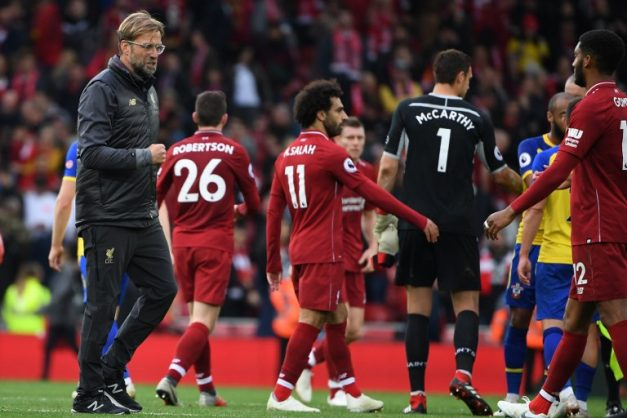 Liverpool and Manchester City s shootout for the Premier League title  intensified on Saturday with comfortable wins over Southampton and Cardiff 35a6ba1a4