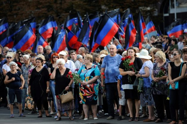 People line the streets of Donetsk to pay respects to assassinated rebel leader Alexander Zakharchenko in east Ukraine. Picture: AFP/Aleksey Filippov