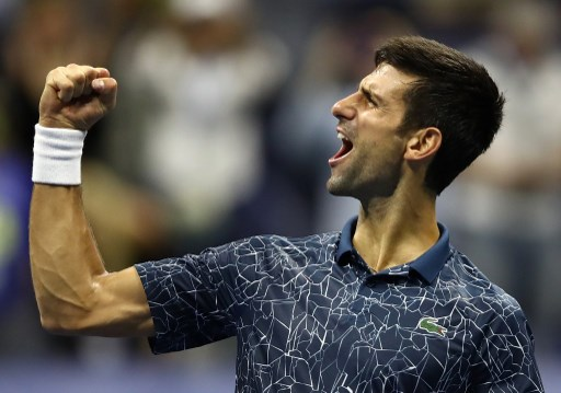 Novak Djokovic of Serbia celebrates victory following his men's singles semi-final match against Kei Nishikori of Japan on Day Twelve of the 2018 US Open at the USTA Billie Jean King National Tennis Center on September 7, 2018 in the Flushing neighborhood of the Queens borough of New York City.   Julian Finney/Getty Images/AFP