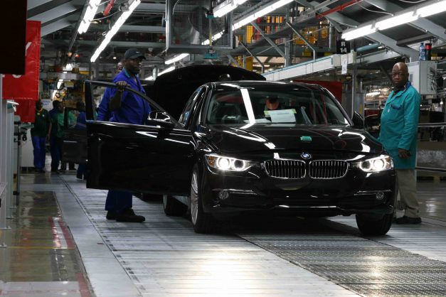Employees work on the BMW assembly line in Rosslyn, north of Pretoria. Picture: Moneyweb