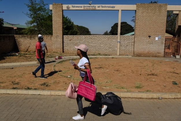 A TUT student is seen rushing to board a bus to get home after students recieved a notification asking them to leave residences for their own safety due to an impending protest for justice of the student, Katlego Monareng, who was shot and killed by police during an SRC protest, 12 September 2018, Soshanguve TUT North Campus, Pretoria. Picture: Jacques Nelles