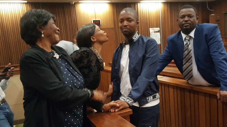 Mark Zinde surrounded by his late mother Hope's family, who supported him in court after he beat her to death. Picture: Ilse de Lange.