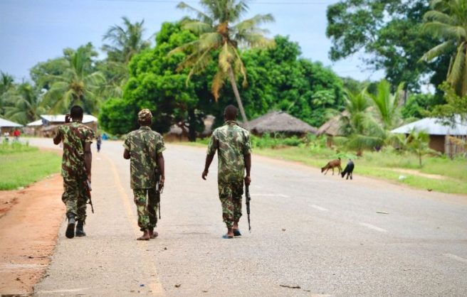 Mozambican troops patrol the streets of Mocimboa da Praia in Mozambique's north, a marginalised region where radical Al-Shabaab-style ideology has found a receptive audience (AFP Photo/Adrien Barbier)