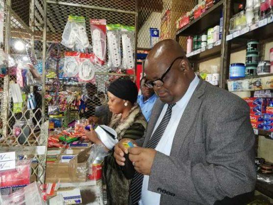 Inspecting goods in one of the shops on Thursday is uMlalazi Mayor Thelumoya Jeke Zulu