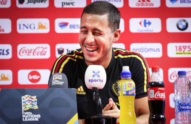 Belgium's footballer Eden Hazard reacts during a press conference of the Belgian national team the Red Devils in Tubize, on October 11, 2018, on the eve of their second game in the Nations League against Switzerland. - Belgium plays their second game in the Nations League against Switzerland on Friday. (Photo by VIRGINIE LEFOUR / various sources / AFP) / Belgium OUT