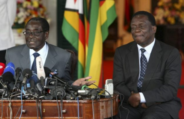 FILE PICTURE: Zimbabwean President Robert Mugabe and Emmerson Mnangagwa at the Presidential State House on July 30, 2013, in Harare, Zimbabwe.  (Photo by Gallo Images / Sunday Times / Simphiwe Nkwali)