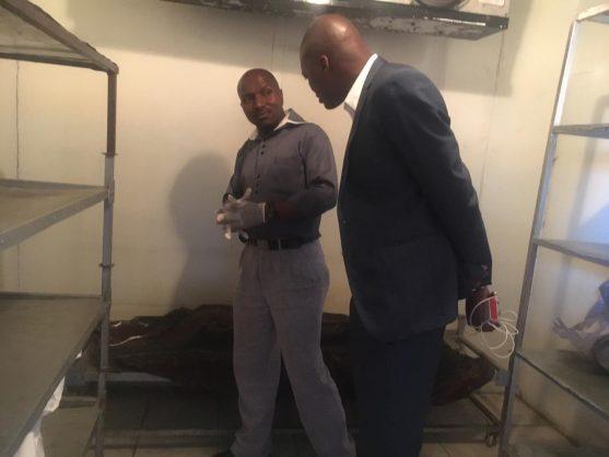 Zwakele Mncwango visiting the morgue with funeral parlour director Siphiwe Mchunu.