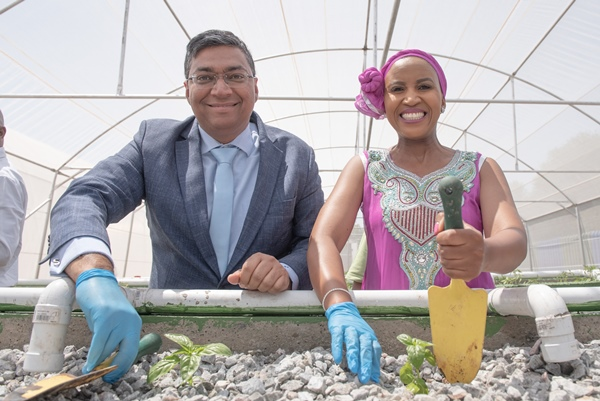 Mondelez Africa MD Swadheed Sharma, left, and Gauteng MMC for Health and Social Development Cllr Mpho Phalatse pose for pictures during the launch of a new aquaponics facility in Soweto, 11 October 2018. Picture: Refilwe Modise