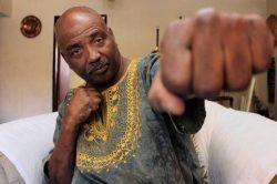 Wheelchair-bound boxing champ still oozes charisma