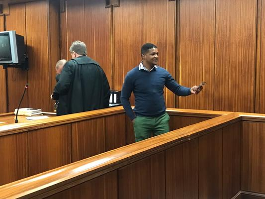 Ex-cop Walter Francis removes his golf watch and hands it over to a relative after he was sentenced to six years in prison on Friday. Picture: Raahil Sain/ANA