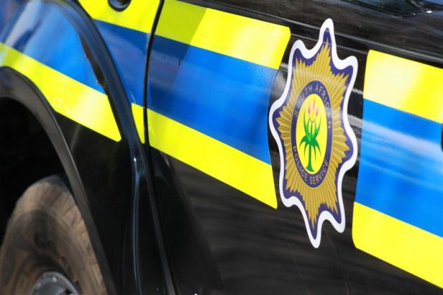 Man tries to rob motorist in front of police car