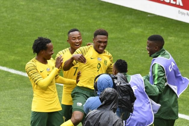 Lebo Mothiba of South Africa celebrates scoring a goal with Percy Tau during the 2019 Africa Cup of Nations qualification match between South Africa and Seychelles at FNB Stadium on October 13, 2018 in Johannesburg, South Africa. (Photo by Lefty Shivambu/Gallo Images)