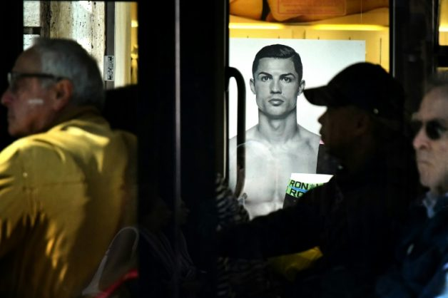 A Rome bus drives past an advertising poster for an underwear brand, showing a picture of Juventus' Portuguese forward Cristiano Ronaldo | © AFP/File | Alberto PIZZOLI