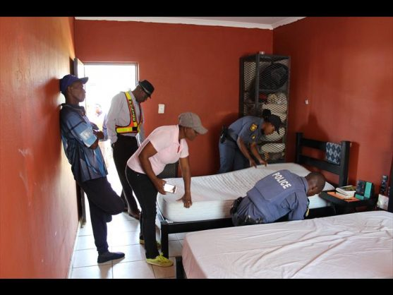 Mamelodi West police hard at work looking for drugs. Photo: Stephen Selaluke