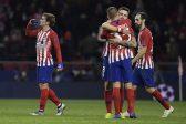 Atletico gain sweet revenge by cruising past Dortmund
