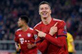 Lewandowski double leaves Bayern on verge of last 16