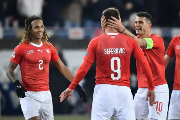 (From L) Switzerland's defender Kevin Mbabu, teammate Haris Seferovic and midfielder Granit Xhaka celebrate their team's third goal during the UEFA Nations League, league A, group 2 football match between Switzerland and Belgium at the Swissporarena stadium in Lucerne, on November 18, 2018. (Photo by Fabrice COFFRINI / AFP)