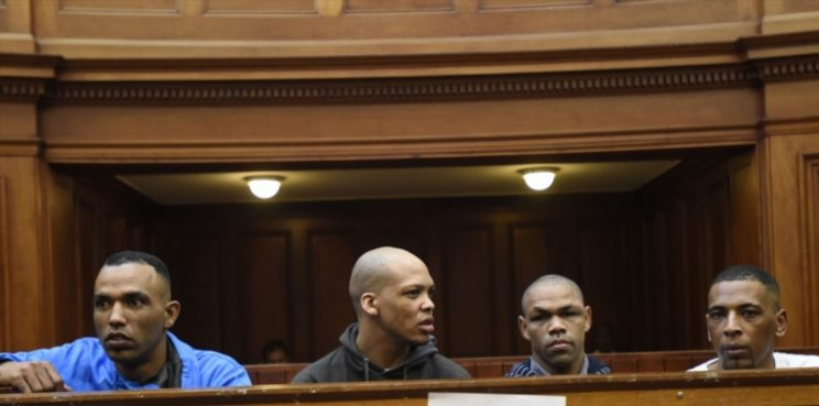 Vernon Witbooi' Geraldo Parsons' Eben van Niekerk and Nashville Julius during sentencing proceedings in the Hannah Cornelius rape and murder case at the Western Cape High Court on November 12, 2018 in Cape Town, South Africa. Witbooi, Parsons, Van Niekerk and Julius were found guilty of murder, aggravated robbery, kidnapping and rape of Hannah Cornelius and assault of her friend Cheslin Marsh, whom they left for dead on May 27, 2017. (Photo by Gallo Images / Brenton Geach)