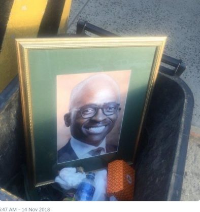 A framed picture of Malusi Gigaba in a bin. Picture shared on Twitter by @AdvBarryRoux Following Following @AdvBarryRoux