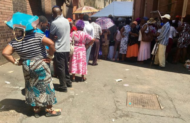 There are no chairs and a lack of toilets for the long queues of Sassa beneficiaries at Pietermartizburg post office. Picture: Nompendulo Ngubane
