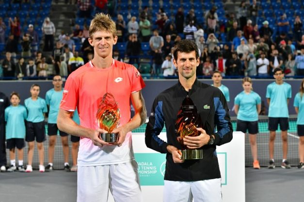 Serbia's Novak Djokovic and South Africa's Kevin Anderson pose at the end of the Mubadala World Tennis Championship 2018 in Abu Dhabi, on December 29, 2018. - Djokovic won a fourth Mubadala World Tennis Championship title, coming back from a set down to beat Kevin Anderson 4-6, 7-5, 7-5. (Photo by GIUSEPPE CACACE / AFP)