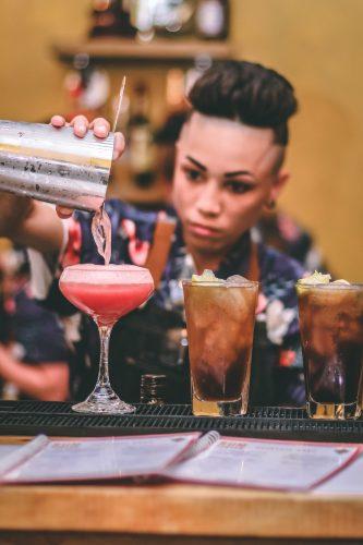 bar tender mixing cocktail