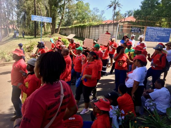 Striking workers barricade the gates of the Fort Napier Medico Legal Mortuary in Pietermaritzburg on Thursday. Photo: Nompendulo Ngubane