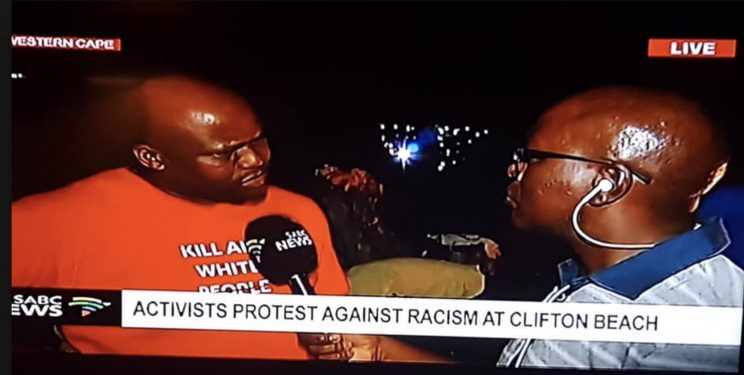The 'activist' attending an 'anti-racism' protest on Clifton beach. Picture: Facebook screenshot
