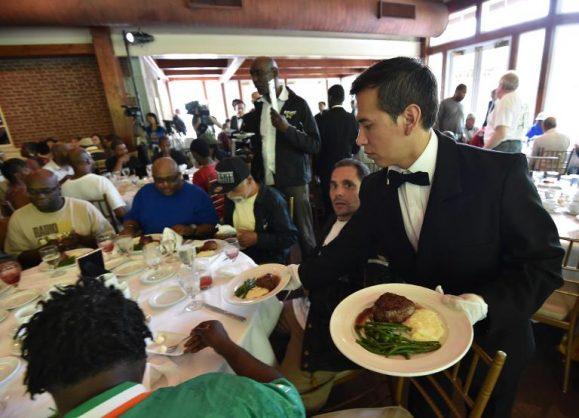 A waiter serves meals.