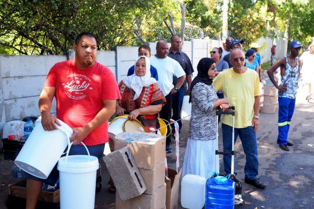 Cape Town residents queuing for water during the water crisis. Shutterstock