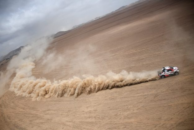 Toyota's driver Nasser Al-Attiyah of Qatar and French co-driver Mathieu Baumel compete in the Dakar Rally Stage 4 between Arequipa and Tacna, in Peru, on January 10, 2019. (Photo by Franck FIFE / AFP)