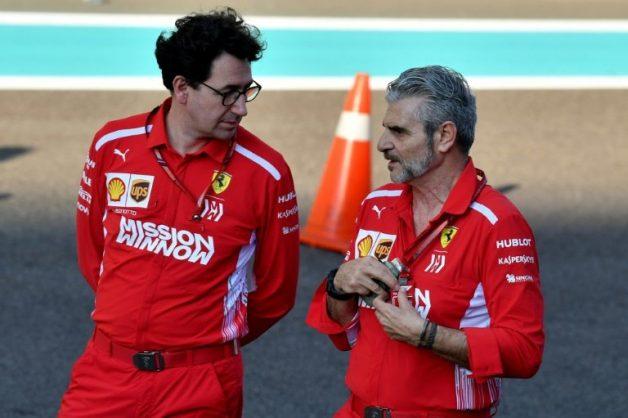 Ferrari Team Principal Maurizio Arrivabene (R) talks to technical director Mattia Binotto (L) ahead of the Abu Dhabi Grand Prix on November 22, 2018. . AFP/Andrej ISAKOVIC