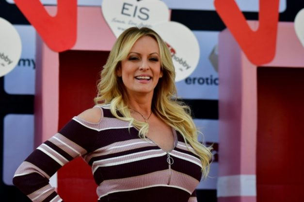 Porn star Stormy Daniels told her Twitter and Instagram followers they can watch her fold laundry live in her underwear instead of watching President Donald Trump's Oval Office speech. AFP/File/Tobias SCHWARZ