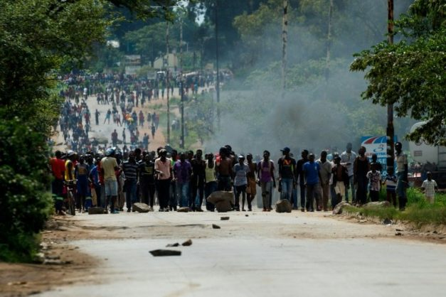 Nationwide demonstrations erupted after Zimbabwe's president announced that fuel prices were being more than doubled . AFP/File/Jekesai NJIKIZANA