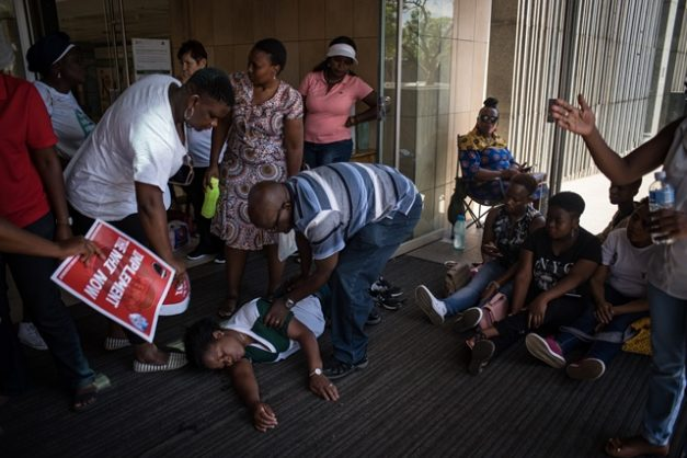 A Department of Health worker passed out shortly after coming from inside the Civitas building where department of Health workers have been protesting their working conditions in the unsafe building, 22 January 2019, Pretoria. Picture: Jacques Nelles