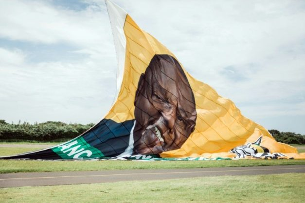 On the up: The ANC hoisted a giant New Year's banner bearing the face of Cyril Ramaphosa, credited with reviving party fortunes after the scandal-hit era of Jacob Zuma. AFP/RAJESH JANTILAL