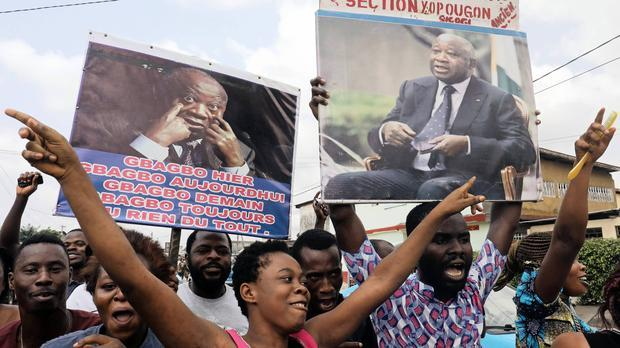 Supporters of former Ivory Coast President Laurent Gbagbo celebrate along a street in Abidjan. Image: ANA