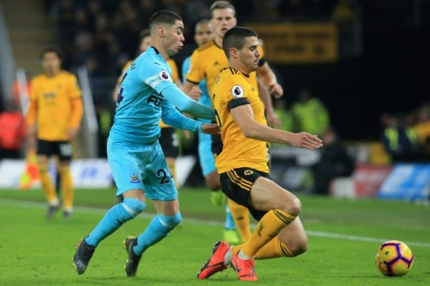 Newcastle's Miguel Almiron challenges Wolves' Conor Coady . AFP/Lindsey PARNABY